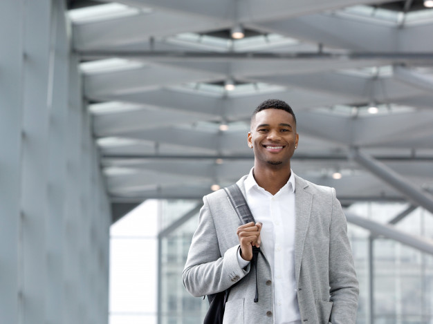 African -american -man -smiling -with -bag -airport _33839-2573